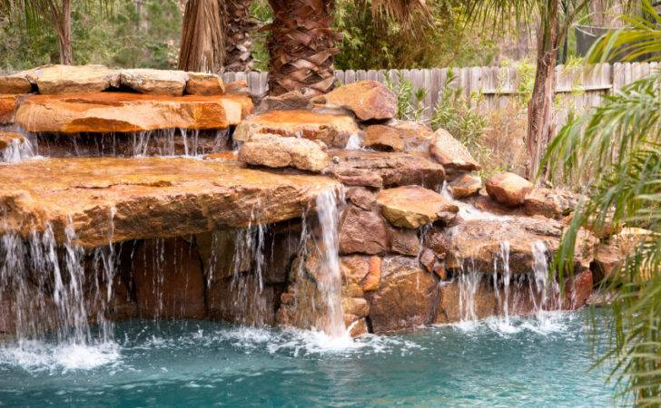Artificial Pool Waterfall High Above Visible Side
