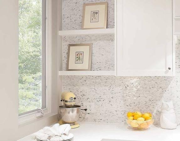 Backsplash Tiles Beside White Floating Shelves Located Adjacent