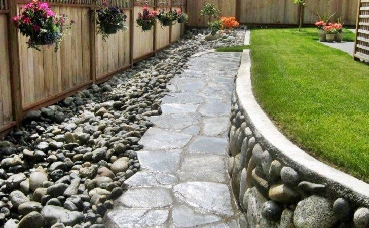Beautiful River Rock Forms Triple Threat Backyard