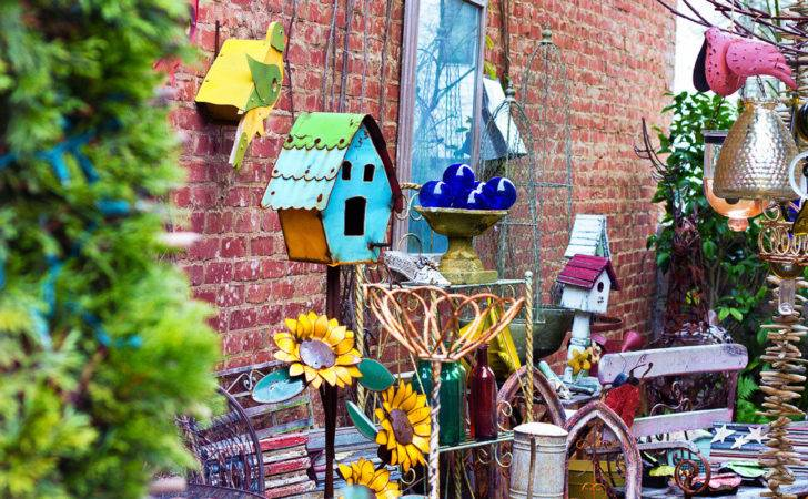 Colorful Yard Art Displayed Between Shops