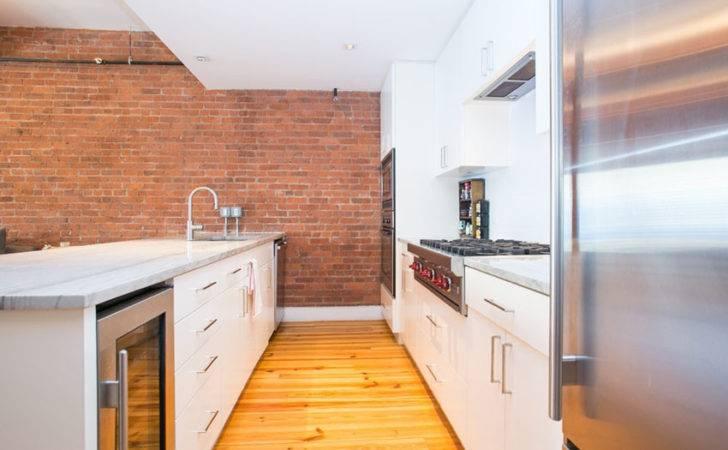 Contemporary Kitchen Brick Veneer Wall