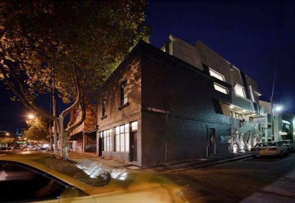 Dynamic Urban Home Exposing Meter High Graffiti Elements House