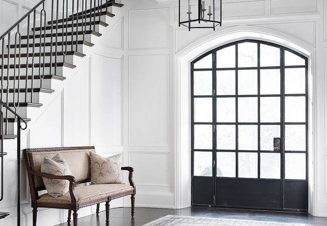 Elegant Foyer Features Floor Ceiling Wainscoting Lined