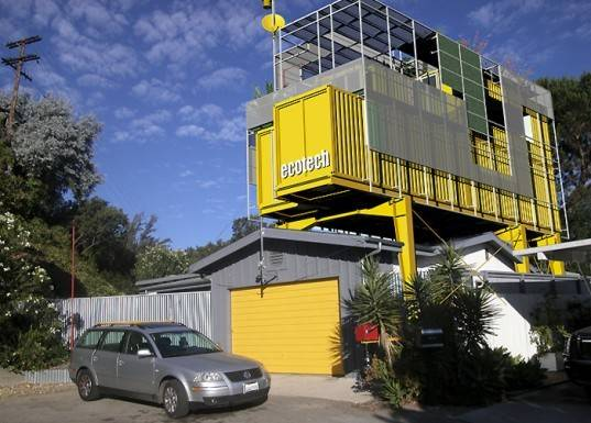 Gives Bungalow Bright Yellow Shipping Container Addition