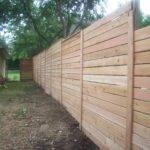 Horizontal Fence Created Perfectly Odd Little Prison Yard