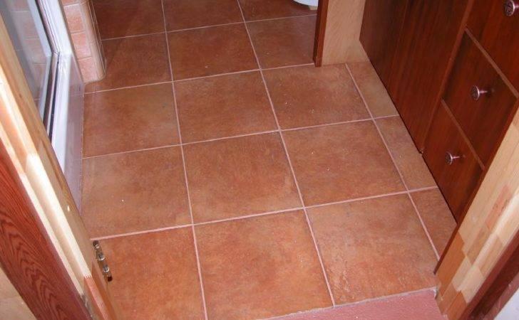 Italian Terra Cotta Style Ceramic Tile Floor Around Basin