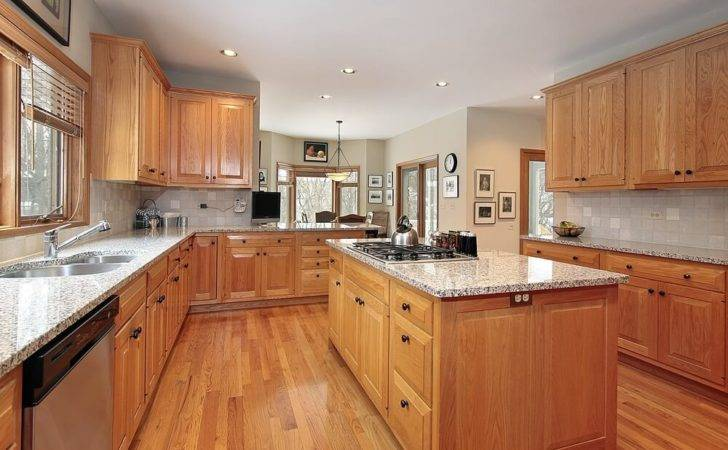 Kitchen Featuring Lighter Wooden Cabinets Medium Colored Hardwood