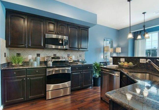 Kitchen Idea Bright Blue Wall Dark Cabinet Weathered Floor Gray