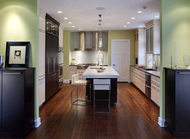 Kitchen Island Features Tall Chairs Sink