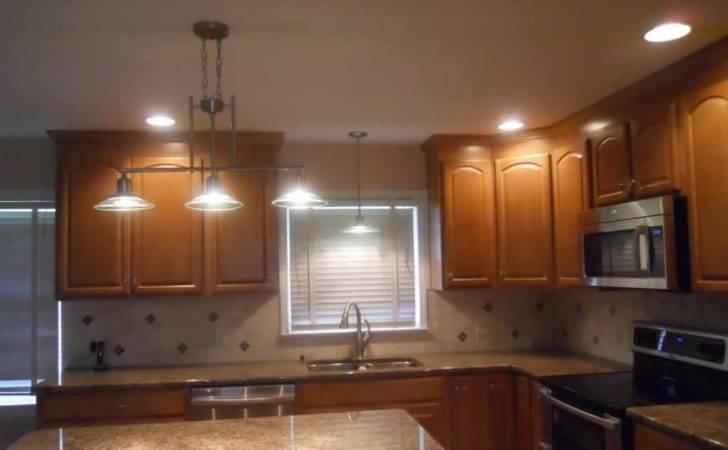 Lighting Ideas Archaic Dark Brown Wooden Cabinets Hanging Pot