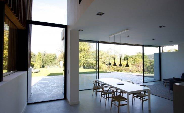 New Build House Uses Floor Ceiling Sliding Glass Doors