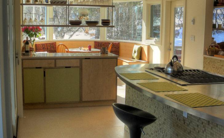 New Curving Glass Windows Surrounding Built Breakfast Bench