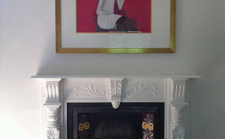Plenty White Space Sits Well Over Dramatic Fireplace