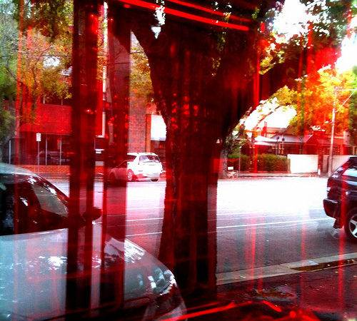 Red Glass Brick Reflection Off Shopfront Window