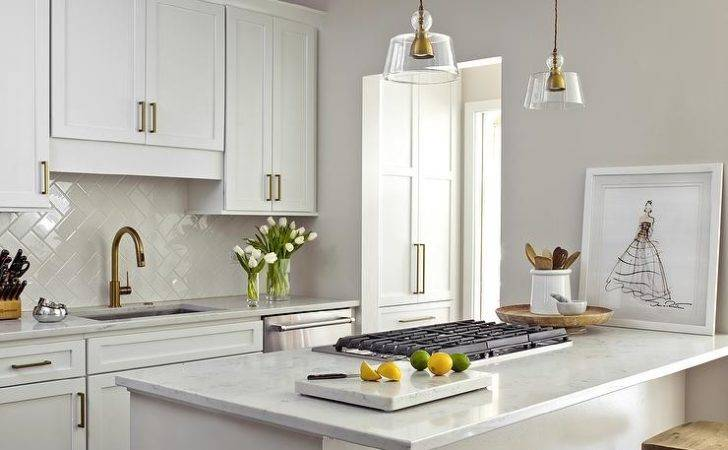 Small White Kitchen Gray Accents Boasts Peninsula Topped