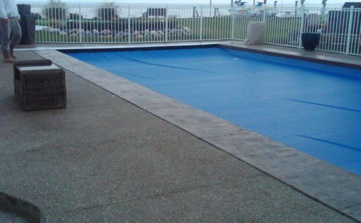 Stamped Concrete Border Installed Around Vinyl Liner Swimming Pool