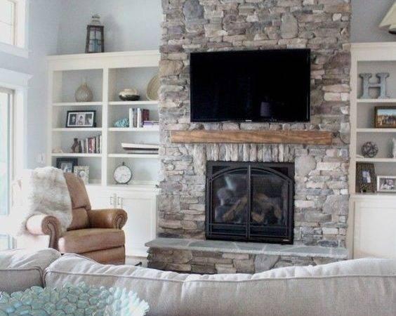 Stone Fireplace Open Shelving Cozy Coastal Living Area