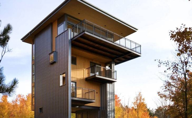 Storey Tall House Reaches Above Forest Lake