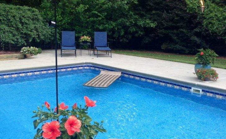 Tiki Torches Flowers Around Pool Inground Pools