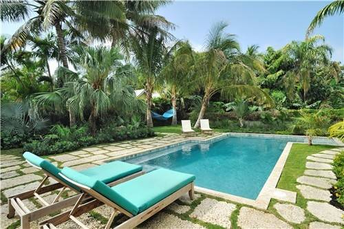 Tropical Pool Chaise Lounges Palms Greensoutheast Landscapingcraig