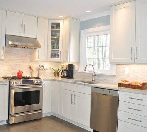 White Cabinets Backsplash Stainless Steel Appliances