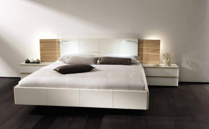 White Floating Bed Frame Above Black Floor Design